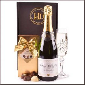 Buy them a beautiful bottle of Champagne with a box of Champagne Truffles.